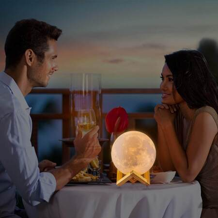 Romance couple with moon lamp