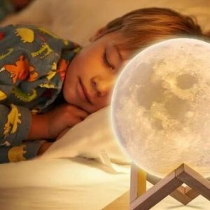 Kid Sleeping with moon lamp - Moon lamp Australia